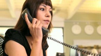 stock-footage-business-female-answering-phone-call-in-office